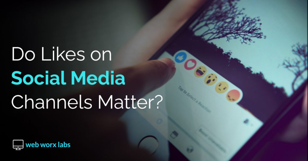 Do Likes On Social Media Even Matter? A Banner Image for Blog showing smartphone with social media app and emojis | Web Worx Labs